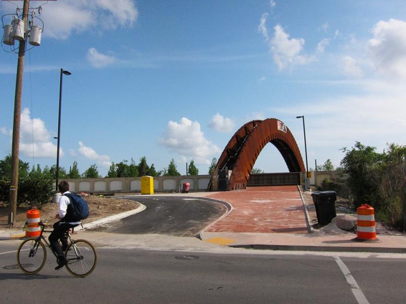 rusty bridge and biker